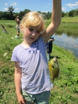 Mae and a fat sunfish from the farm pond