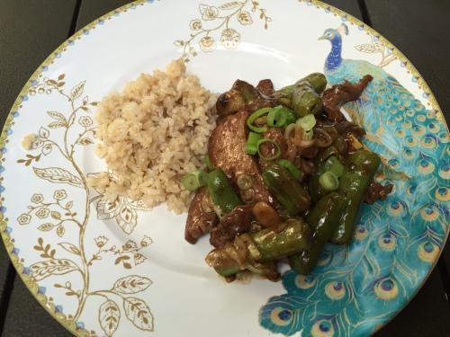Stir-fried flank steak with leeks, snap peas and mushrooms