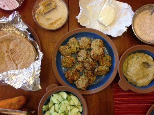 Last night's Mediterranean feast: turkey-zucchini patties stuffed into pita with delicious dips, including the smoky eggplant spread bottom-right